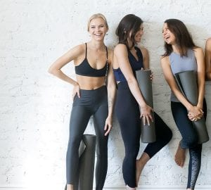 women posing in yoga apparel