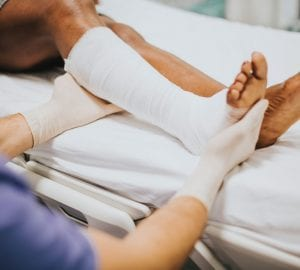 a person getting a cast on their leg