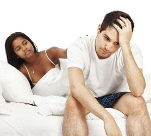 man and woman sitting in bed