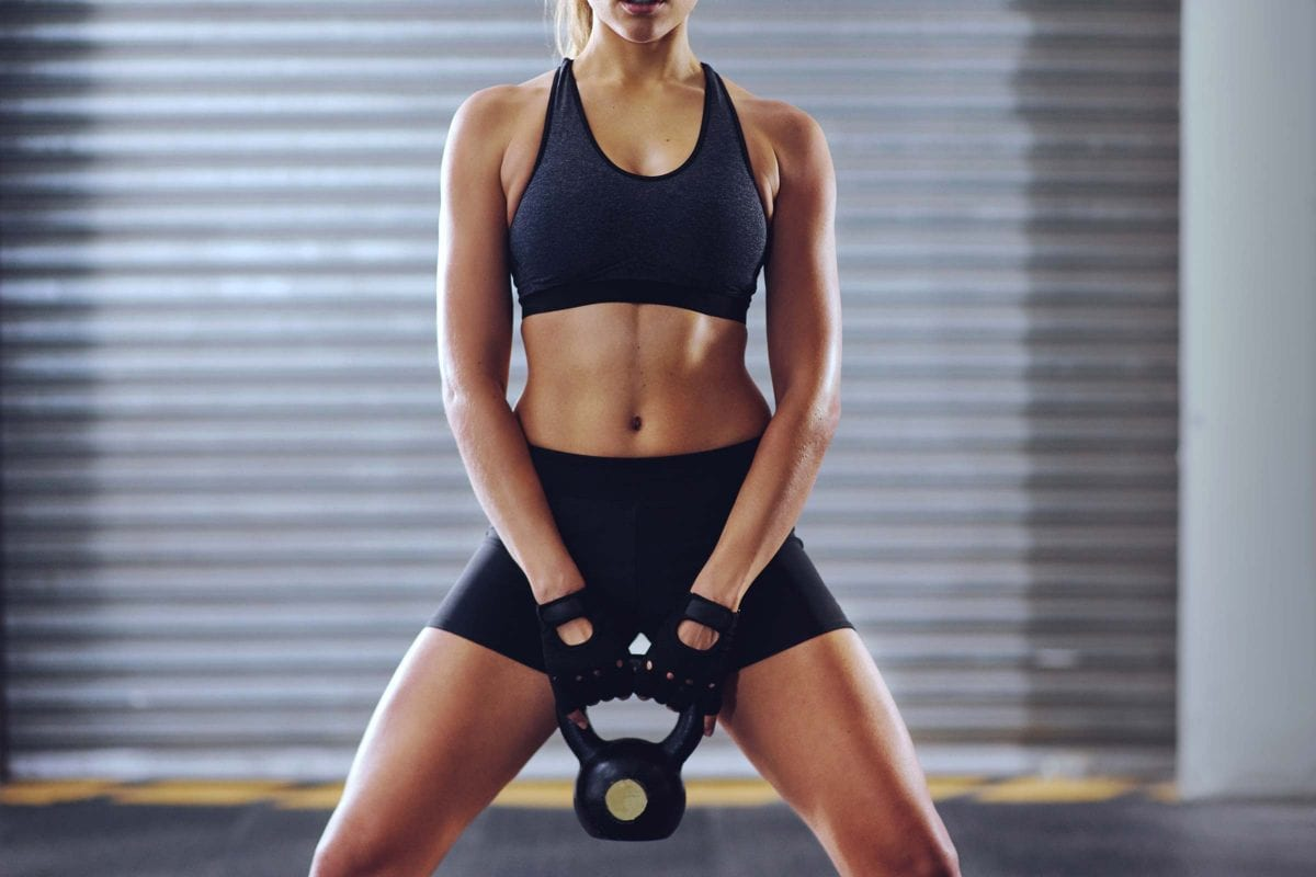 woman exercising with a kettlebell
