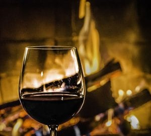 wine in front of a fire