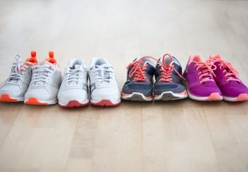 a lineup of different pairs of walking shoes