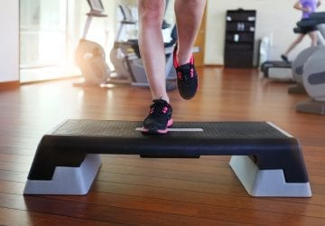 a person exercising on a step at the gym
