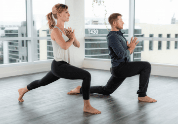 couple doing a yoga pose in the studio