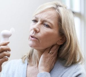 woman experiencing hot flashes