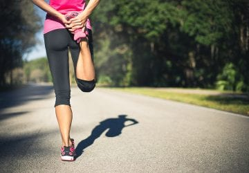 woman stretching before going on a run