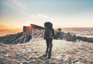 person backpacking in the mountains