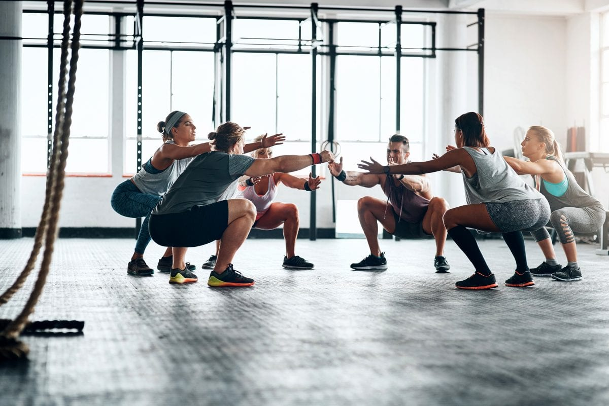 Shot of a fitness group working out at the gym