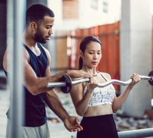 a personal trainer working with their client