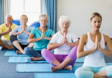 a group of seniors doing yoga