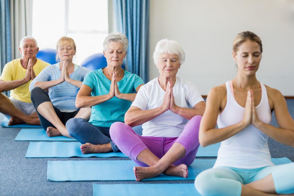 a group of seniors doing yoga
