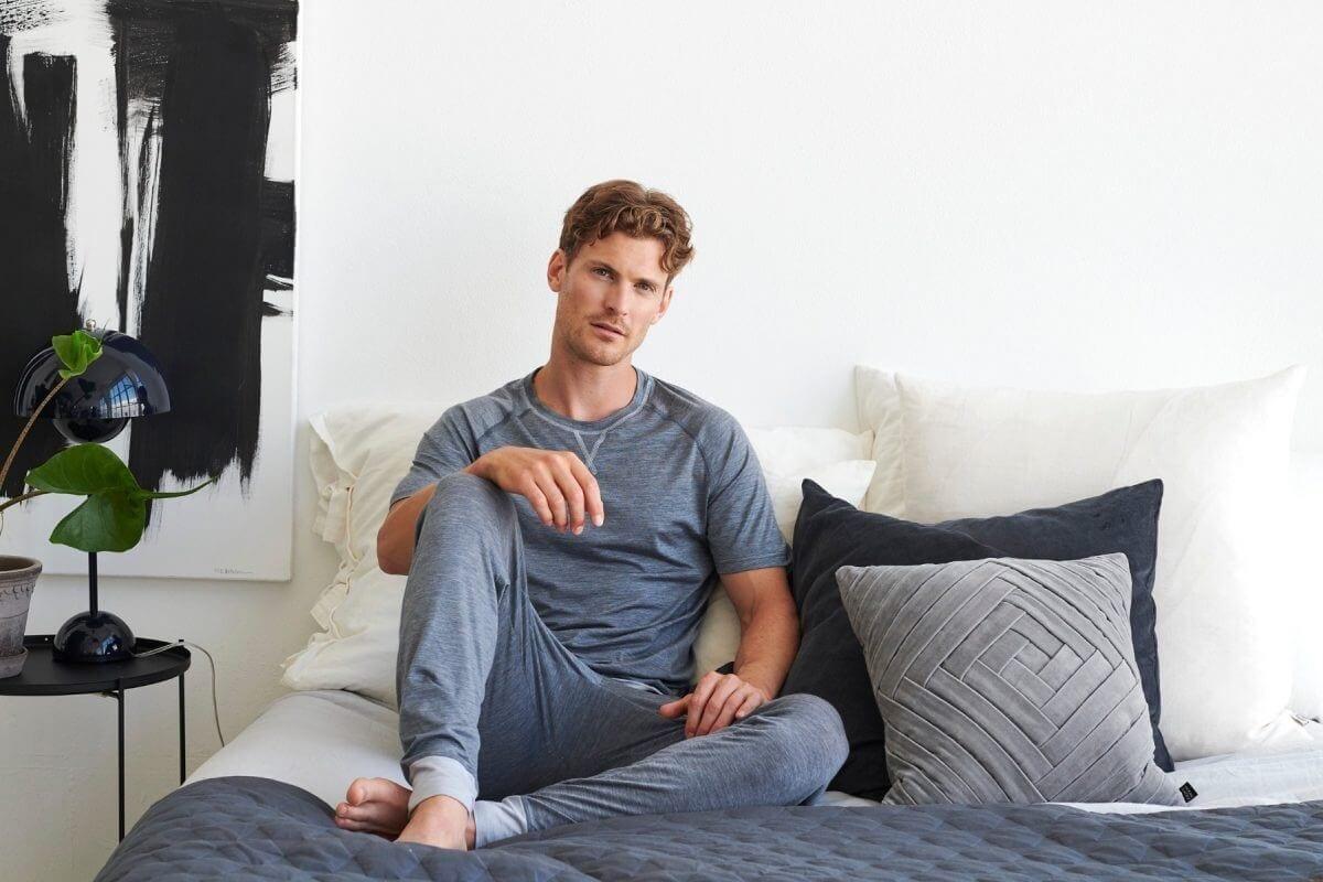 man sitting in his pyjamas in bed