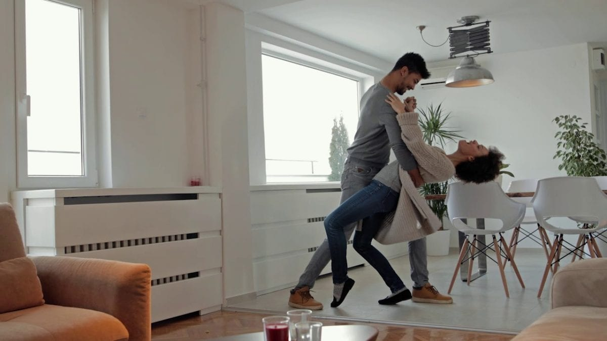 a couple dancing in their living room
