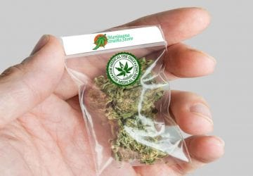 a person holding a package of cannabis