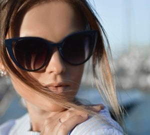 woman outdoors wearing sunglasses