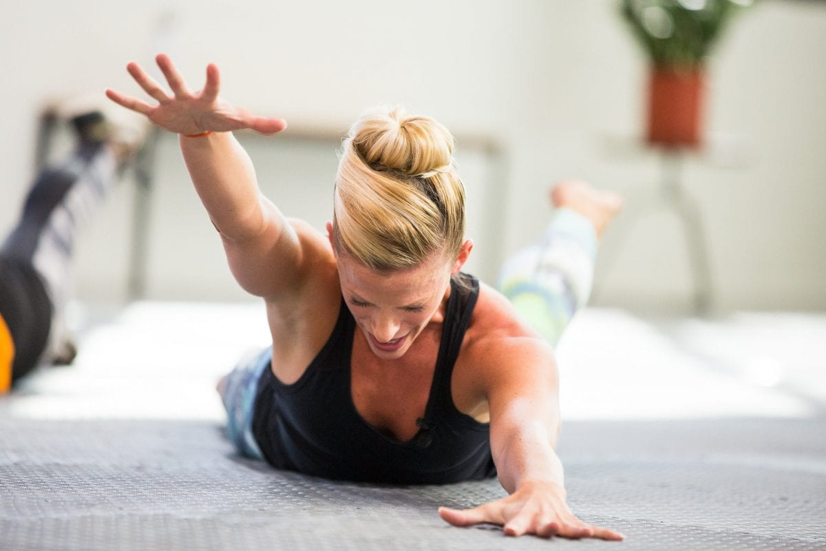 a woman doing back exercises