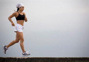 a woman running in the fog