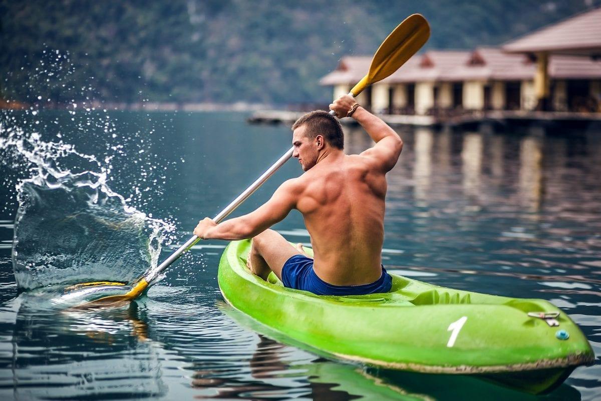 strong man kayaking