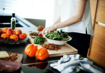 a woman cooking a healthy meal