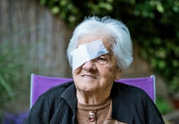 an elderly woman with macular degeneration