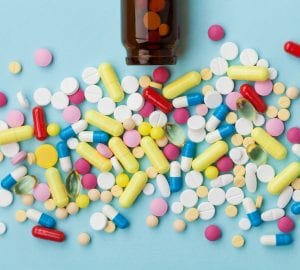 an assortment of pills on a table