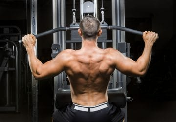 a man exercising his back