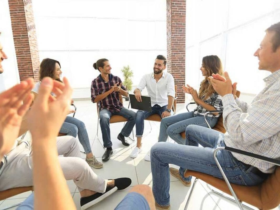 a group cheering in a counselling session