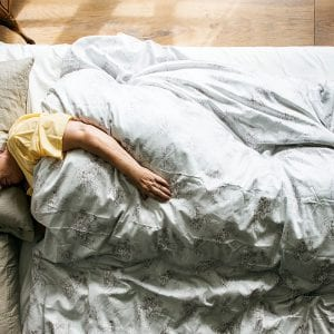 an older woman in her bed sleeping