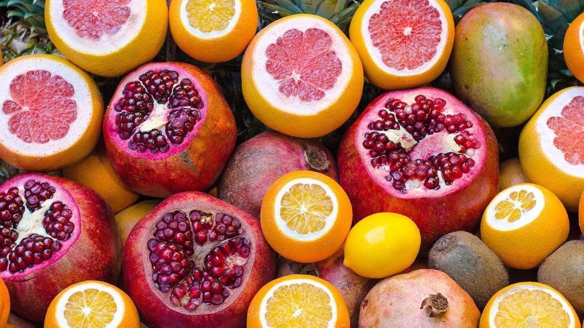 an assortment of citrus fruits