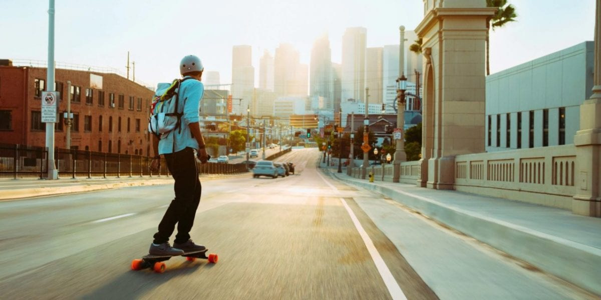 a man commuting to work on a skateboard