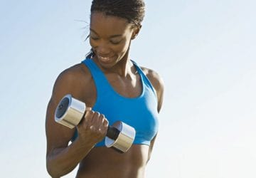 a woman doing bicep curls