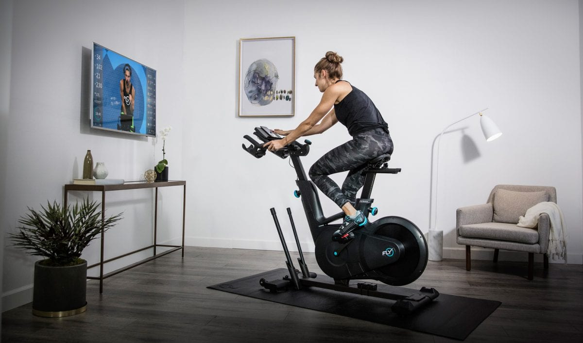 a woman spinning on an exercise bike