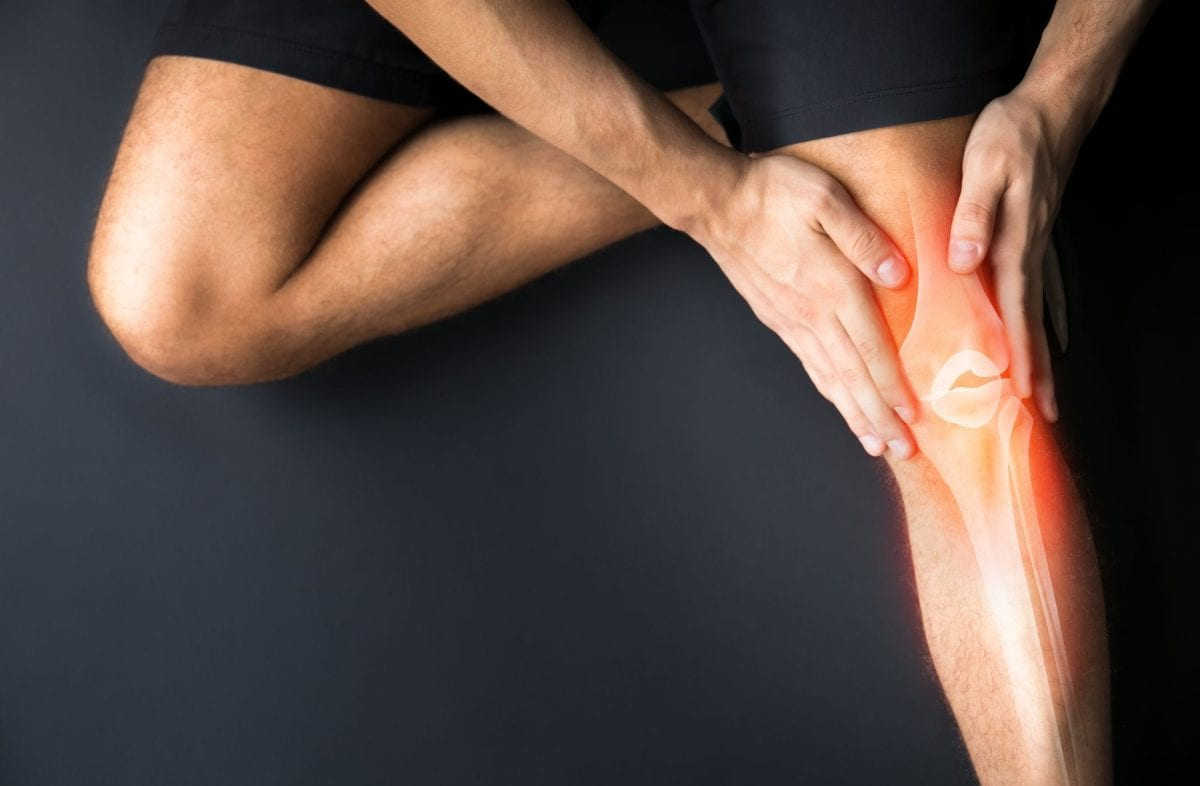 a person holding their knee