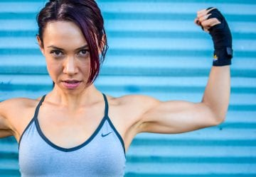 a woman flexing her biceps
