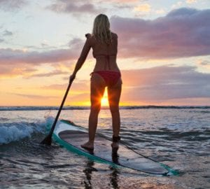 a woman on a SUP paddleboard