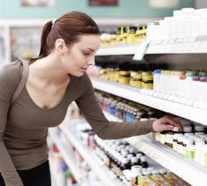 Female customer buying medicines from the store