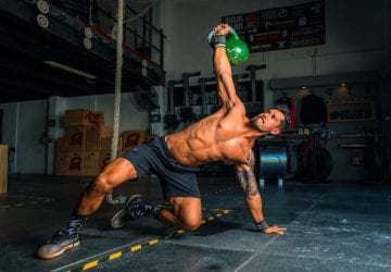 a man working out with a kettlebell