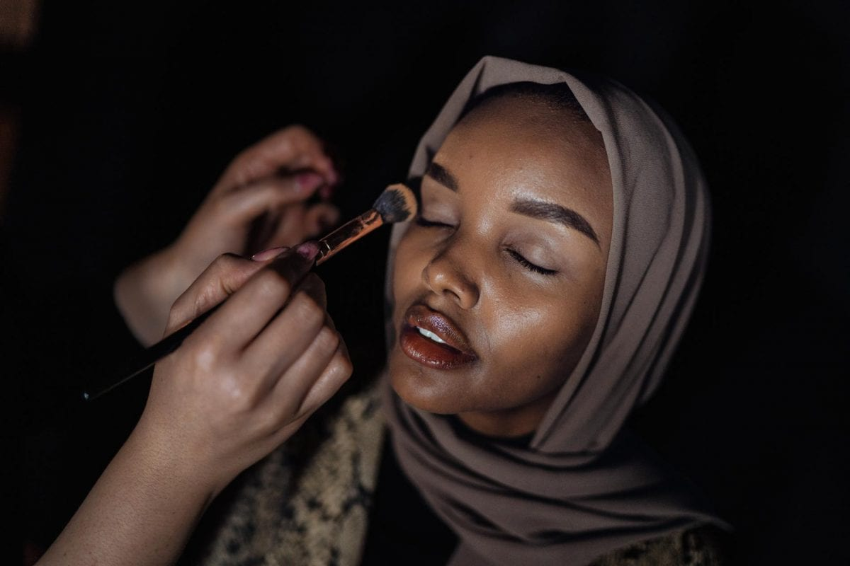 a woman applying makeup