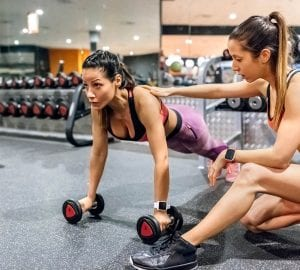 a woman working out with her trainer