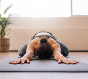 a woman lying face down doing yoga