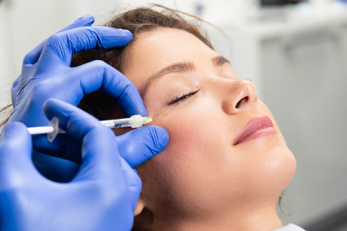 a woman receiving botox in her face