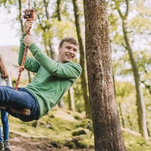 a couple swinging on a tree
