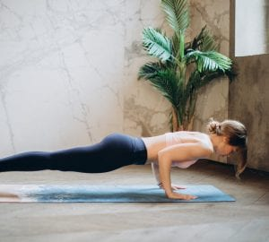 a woman doing planks