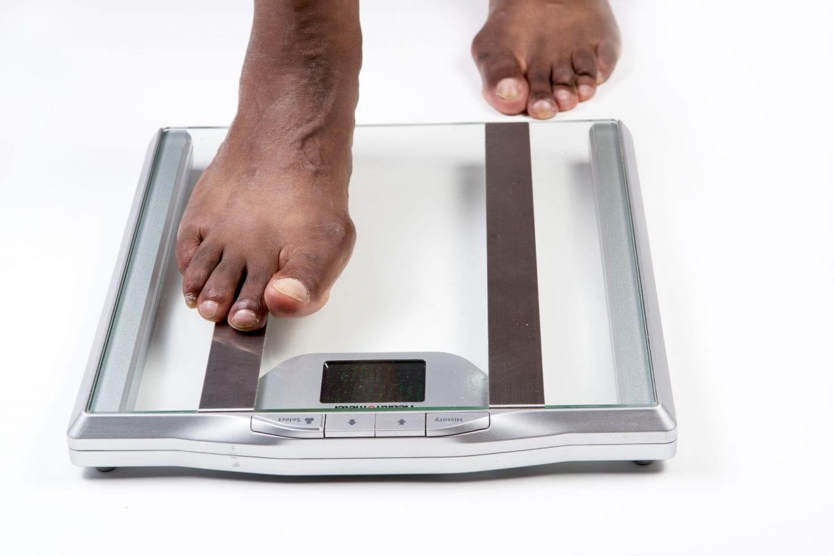 A man stepping on a scale
