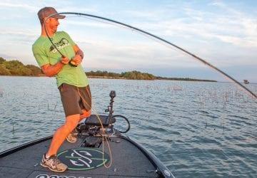 a man catching a fish