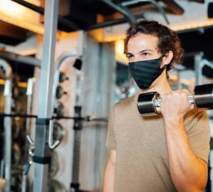 a man working out with a mask