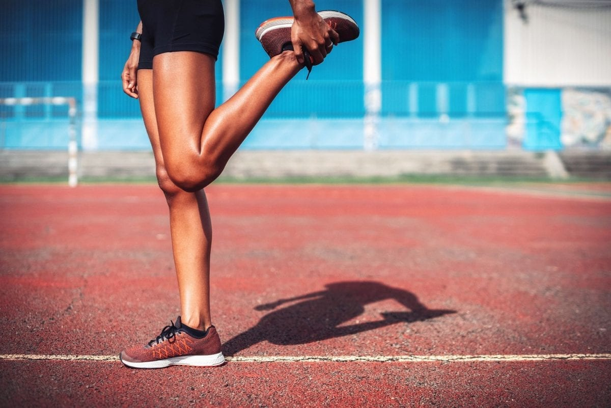 a woman stretching her legs