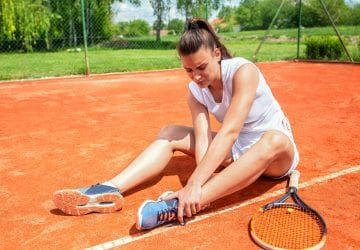 an injured woman on a tennis court