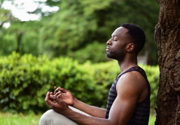 a man doing yoga outdoors