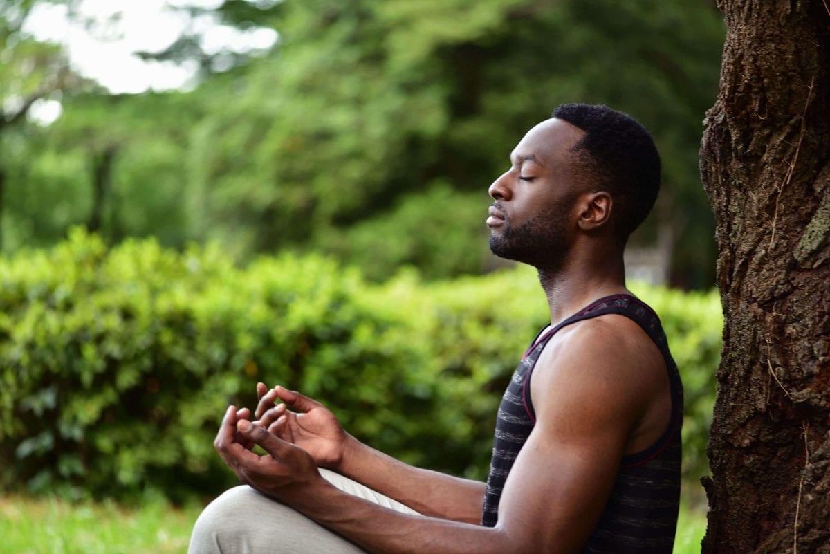 a man doing yoga outdoors
